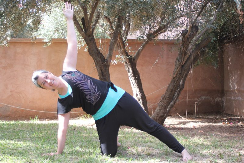 The teacher demonstrating modified side plank pose
