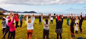 People doing yoga outside in Waterville