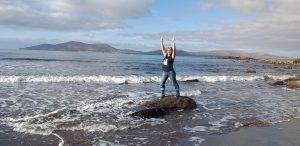 Yoga teacher doing Warrior pose on Waterville beach